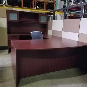 Secondhand mahogany bow front desk with a credenza and glass hutch Used