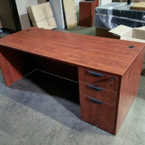 cherry colored straight front desk with bbf pedestal