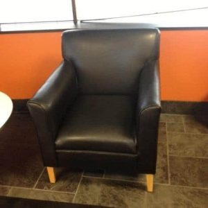 used black leather lobby chair and couch
