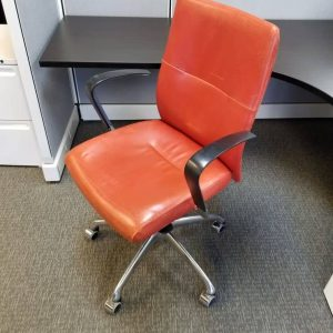 used red Krug leather chairs