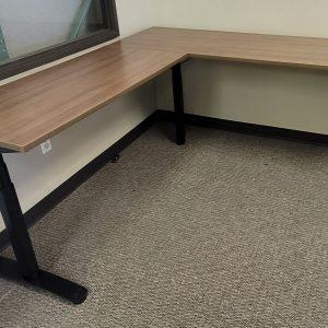 Used SitStand L Shape Adjustable Desks Walnut Finish Black Base