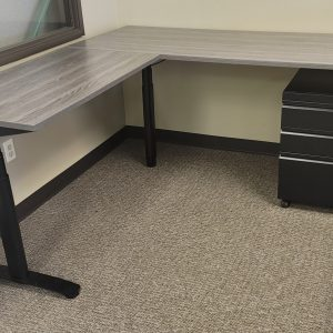 Used Sit Stand L Shape Desks New Gray Finish Black Base